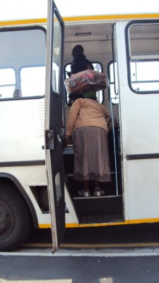 Woman boarding bus with blanket