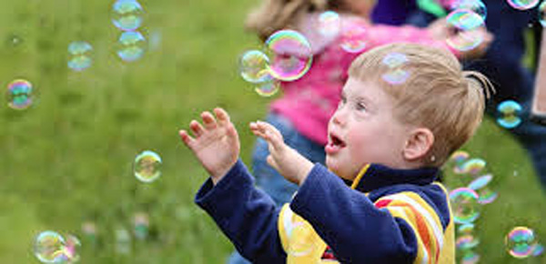 Child with Bubbles, photo by The ARC