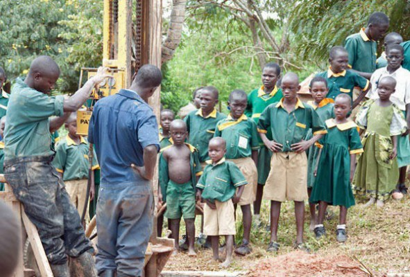 Children watching the drilling