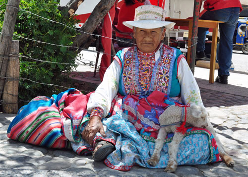 Grandmas and Baby Llama, Peru,  photo by GoErinGo