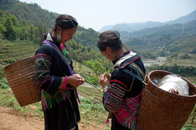 Two of my Hmong guides while on my 3-day trek in Sapa, the hills of Northern Vietnam.