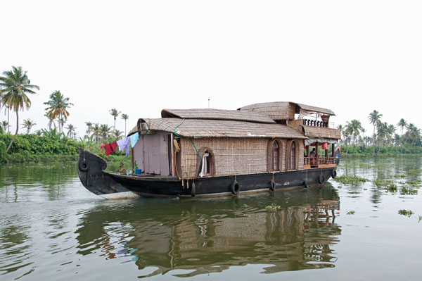 Iconic house boat floating in the backwaters of Kerala, India
