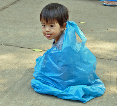 Little Boy in Bag, Northern Thailand, photo by GoErinGo