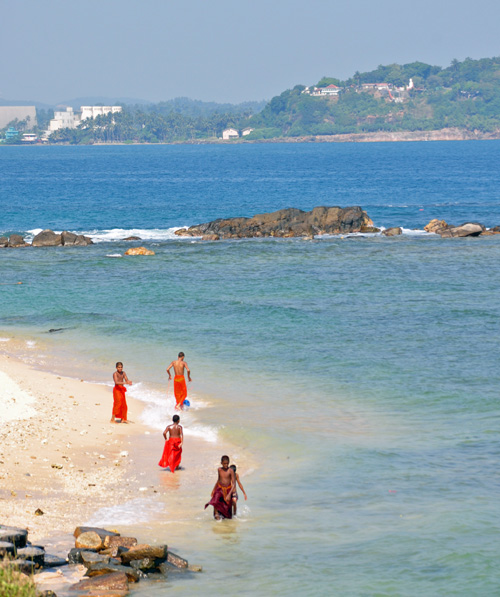 Buddhist Monks on a beach in Galle, at the southern tip of Sri Lanka