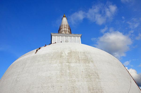 Stupa Cleaners, Sri Lanka photo by GoErinGo