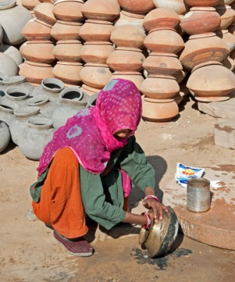 Woman Cleaning Pots