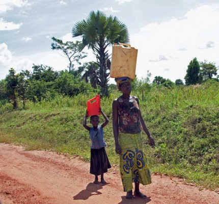 Woman and young girl carrying water